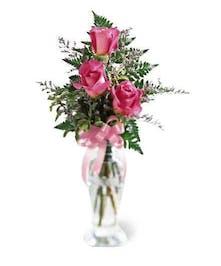 3 roses in a bud vase pink
