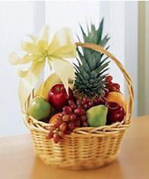 Traditional gift basket filled with assorted fresh fruit