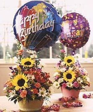Bold bouquet of seasonal flowers with a large Happy Birthday mylar balloon