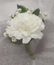 Boutonniere made of a white carnation and baby's breath.