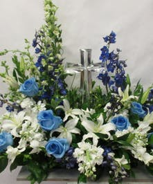 Large crystal cross keepsake surrounded by your choice of sympathy flowers.