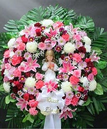 Assorted flowers in a wreath with a keepsake angel, with the inscription