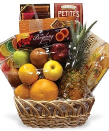 Gift basket filled with assorted fruit and chocolate.
