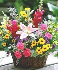 A wicker basket filled with a variety of wildflowers.