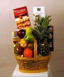 Basket filled with assorted fresh fruit and chocolate items
